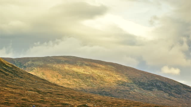 ms t/l pan shot of glen etive heathland with sun and clouds / glen etive, scotland, united kingdom - moor stock videos & royalty-free footage