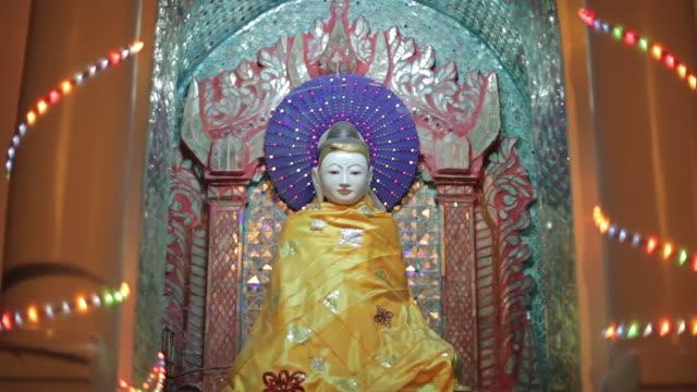 MS Shot of glowing Buddha statue / Yangon, Yangon Division, Myanmar