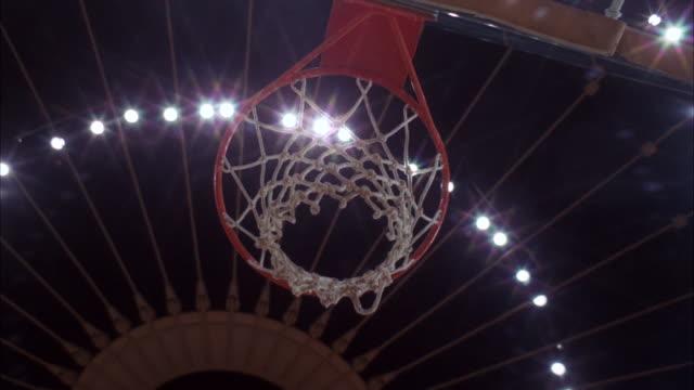 vidéos et rushes de cu shot of goal being done in forum basketball / los angeles, california, united states - ballon de basket