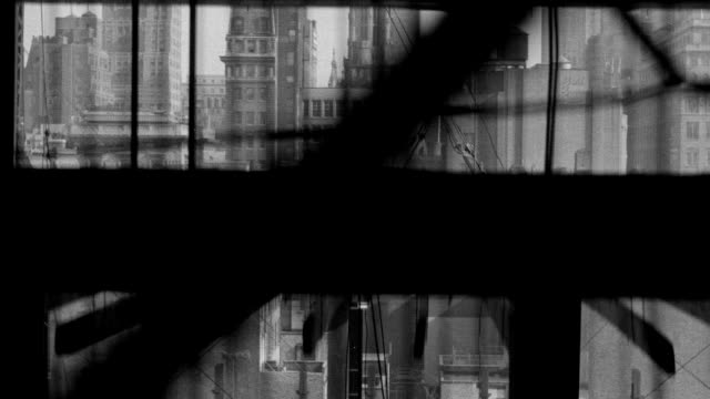ws shot of going up in elevator in building under construction in rockefeller center, new york city, buildings, st patricks cathedral in background - fahrstuhlperspektive stock-videos und b-roll-filmmaterial