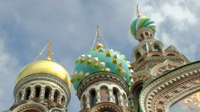 CU TL Shot of gold and green domes from Church of Savior on Spilled Blood aka Cathedral of Resurrection of Christ against cloud filled sky / St. Petersburg, Russia