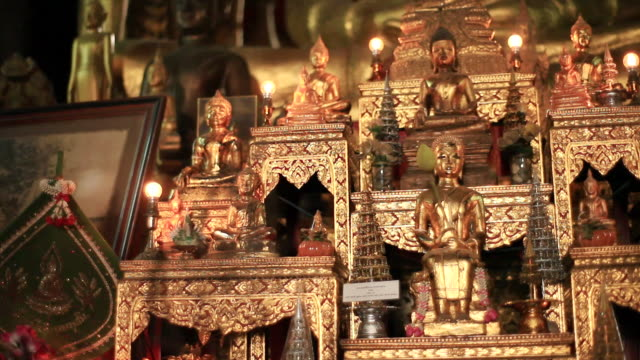 cu pan shot of golden altar filling with small buddhas and lights / luang prabang, laos - male likeness stock videos & royalty-free footage
