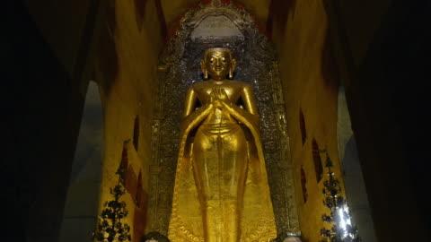 ms tu shot of golden buddha statue in ananda pagoda / bagan, mandalay division, myanmar - male likeness stock videos & royalty-free footage