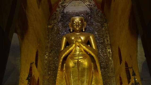 ms tu shot of golden buddha statue in ananda pagoda / bagan, mandalay division, myanmar - male likeness stock videos & royalty-free footage