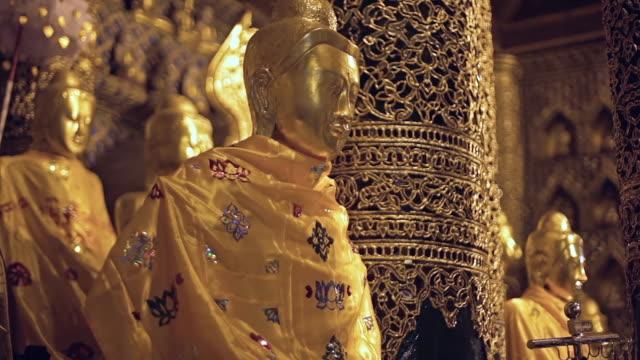 MS Shot of golden Buddha statues / Yangon, Yangon Division, Myanmar
