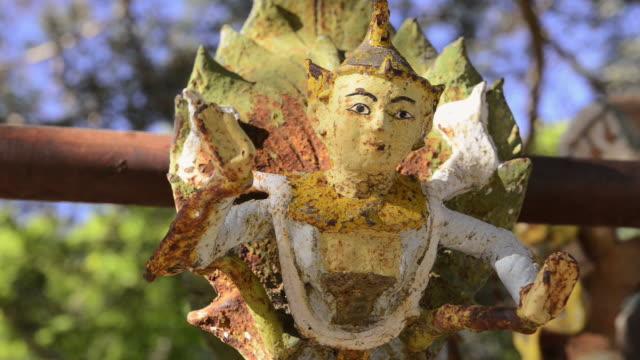 ecu shot of golden figure at dhammayazika temple / bagan, mandalay division, myanmar - bagan stock videos & royalty-free footage
