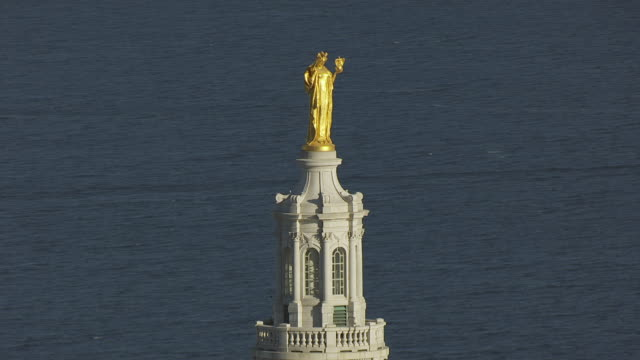 CU AERIAL ZO Shot of Golden Lady at top of State Capitol and State Capitol building in morning light / Madison, Wisconsin, United States