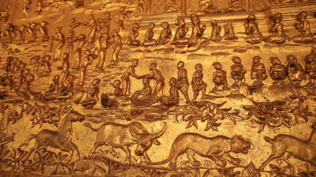 ms pan shot of golden temple wall with bas relief figures / luang prabang, laos - bas relief stock videos & royalty-free footage