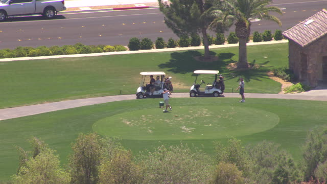 ms aerial shot of golfer swings on golf course / las vegas, nevada, united states - golfer stock videos & royalty-free footage