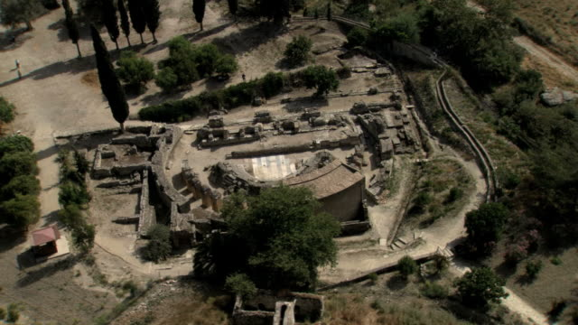 ms aerial ds shot of gortis roman site / gortys, crete, greece - ancient stock videos & royalty-free footage