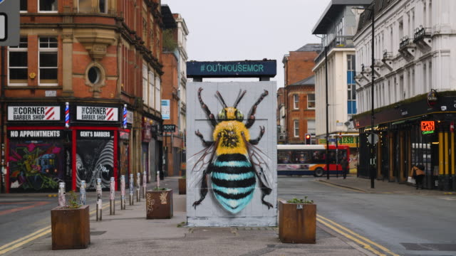 shot of graffiti depicting a colourful bee in the northern quarter, manchester - manchester england stock videos and b-roll footage