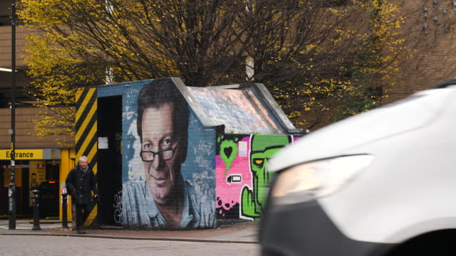 shot of graffiti depicting tony wilson in the northern quarter, manchester - male likeness stock videos & royalty-free footage