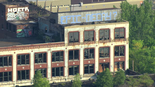 ms aerial shot of  graffiti epic decay sign on abandoned packard motors plant / detroit, michigan, united states - detroit michigan stock videos & royalty-free footage