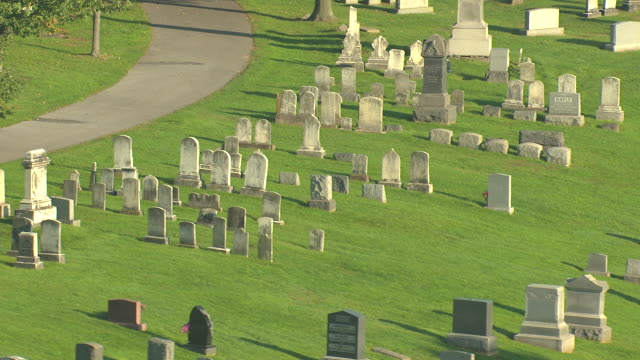 ms aerial shot of graves at cemetery at gettysburg national cemetery / pennsylvania, united states - gettysburg stock videos & royalty-free footage