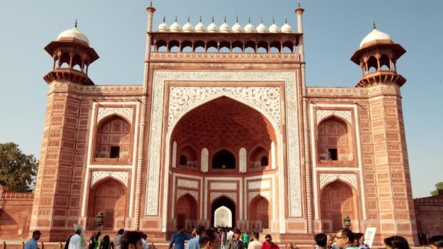 MS Shot of Great Gate Taj Mahal and people walking in front of gate / Agra, Uttar Pradesh, India