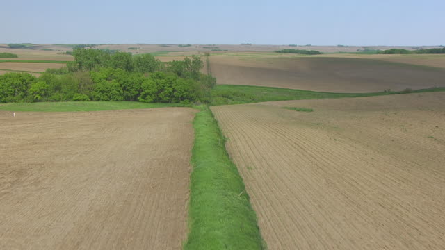 cu aerial tu shot of green strip to reveal farmland / norfolk, nebraska, united states - plowed field stock videos and b-roll footage