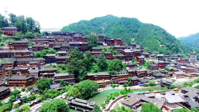 ws aerial shot of grey tiled wooden miao village,guizhou,china. - wood material stock videos & royalty-free footage
