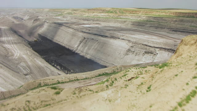 CU AERIAL Shot of Ground to reveal coal trench at North Antelope Rochelle Mine / Wyoming, United States