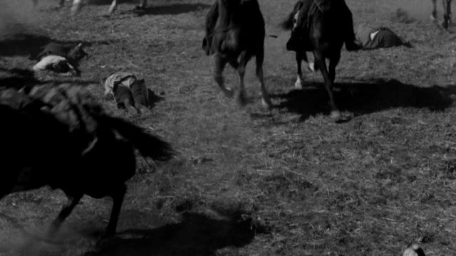MS Shot of group of Indians on horseback charging during battle