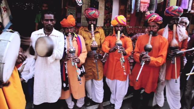 ms pov shot of group of local indian musicians playing in local market audio / pushkar, rajasthan, india  - musical instrument stock videos & royalty-free footage