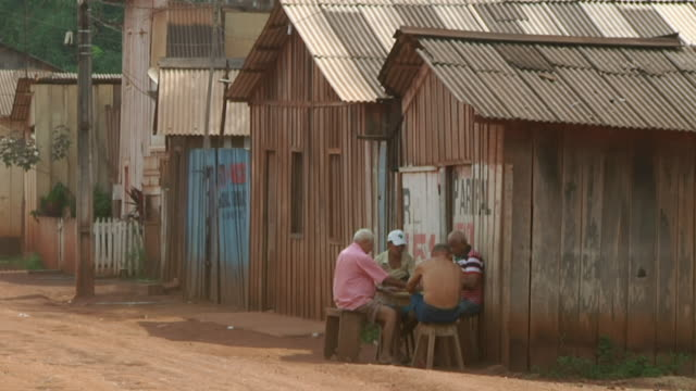 WS Shot of group of people playing on village road / Serra Pelada, Para, Brazil