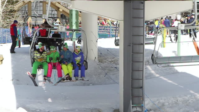 MS Shot of Group of skiers on quad chair lift in winter / Ketchum, Idaho, United States