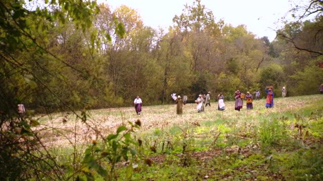 WS POV Shot of group of slaves walk through field / Culpeper, Virginia, United States