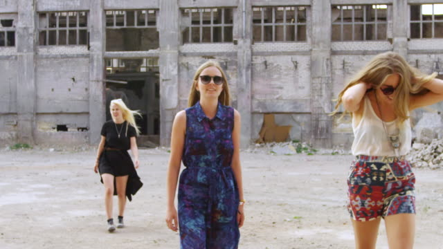 """""""ms slo mo shot of group of women walking outside abandoned building / berlin, germany"""" - bad condition stock videos & royalty-free footage"""
