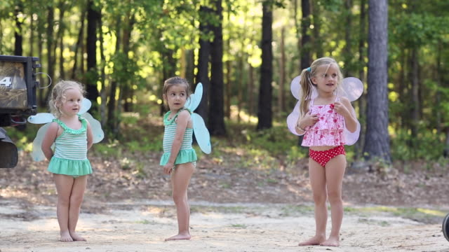 WS Shot of group of young girls wearing fairy wings / St Simon's Island, Georgia, United States