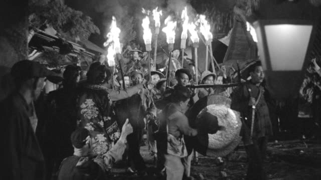 ws shot of group procession torch in their hand and some sitting on horse - gruppo medio di animali video stock e b–roll