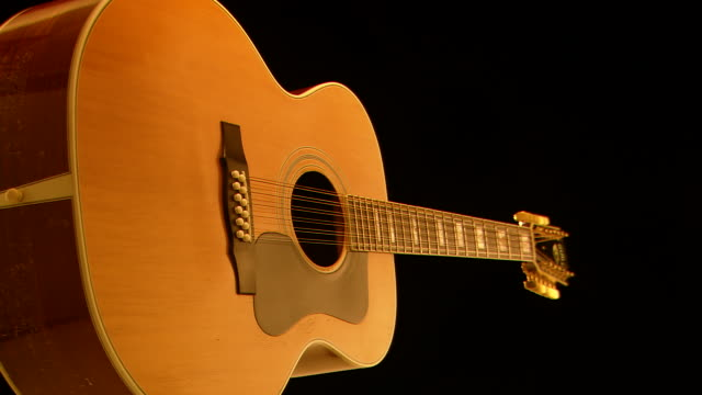 MS Shot of Guild twenty string acoustic guitar with pearl inlays on turntable / Nashville, Tennessee, United States
