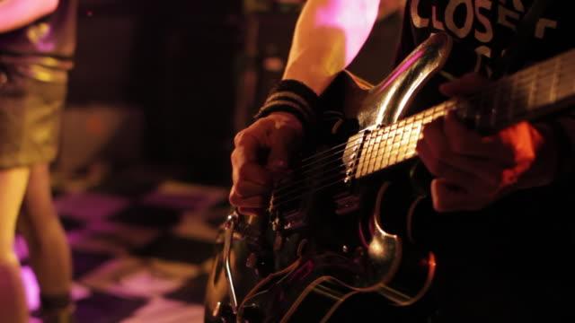 cu tu shot of guitarist playing on the stage / shimokitazawa, tokyo, japan - rock group stock videos and b-roll footage