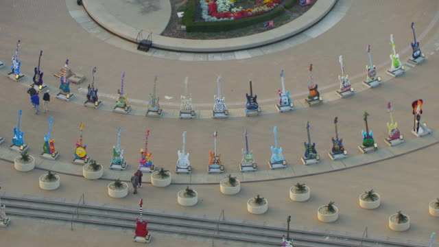 MS ZO AERIAL Shot of guitars on display in outdoor plaza and Rock And Roll Hall of Fame Museum building / Cleveland, Ohio, United States