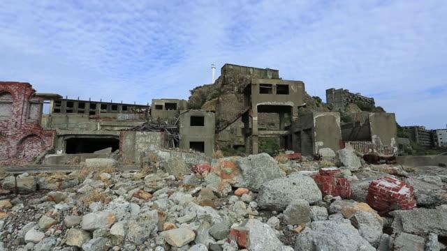 ws pan shot of gunkanjima (hashima island),under world heritage registration / nagasaki, nagasaki prefecture, japan - destruction stock videos & royalty-free footage