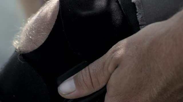 ecu slo mo tu shot of guy adjusting leg brace / venice, california, united states - leg brace stock videos and b-roll footage
