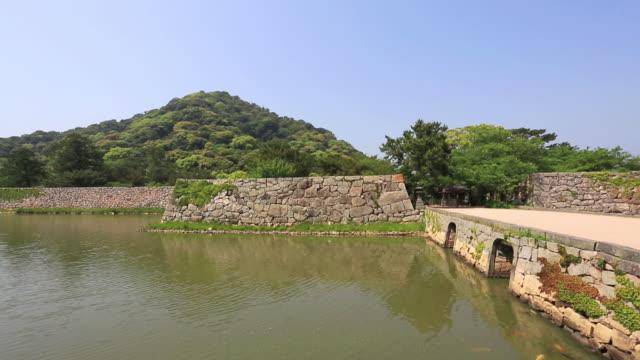 ws pan shot of hagi-jo castle ruins and moat / hagi, yamaguchi prefecture, japan  - 堀点の映像素材/bロール