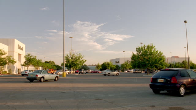 ws tu shot of half empty mall parking lot - parking lot stock videos & royalty-free footage
