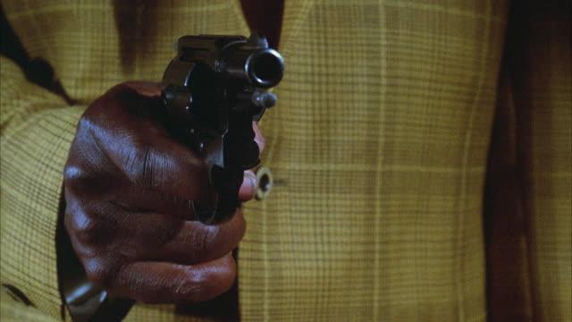 CU Shot of hand firing through revolver