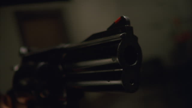 CU Shot of hand holding gun and Firing