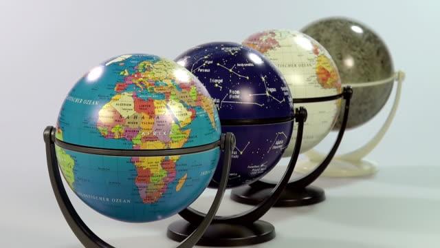 stockvideo's en b-roll-footage met ms shot of hand with globes / saarburg, rhineland palatinate, germany - vier dingen