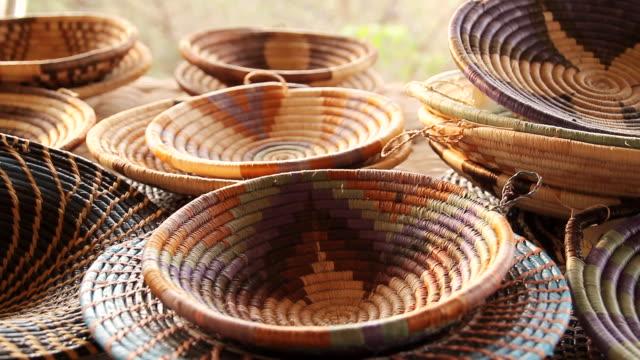 cu r/f shot of hand woven baskets / ghanzi district, ghanzi district, botswana - wiese video stock e b–roll