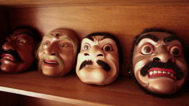 vídeos de stock, filmes e b-roll de cu shot of handmade masks / mas, bali/gianyar/ubud, indonesia - quatro objetos