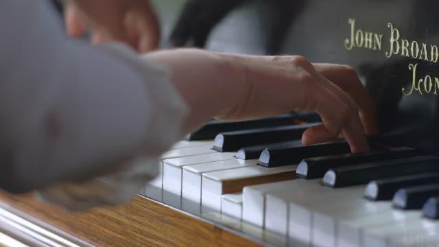 CU Shot of hands and fingers playing John Broadwood piano / United Kingdom