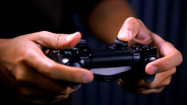 ecu shot of hands holding video game console controlling joystick - leisure games stock videos & royalty-free footage