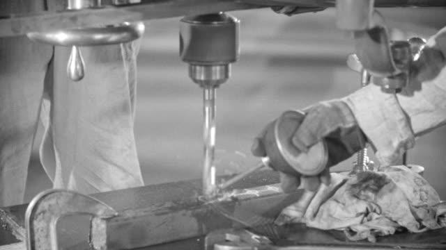 CU Shot of hands operating drill press