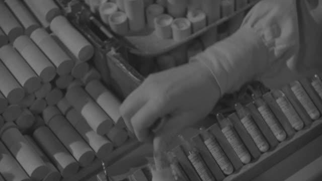 cu shot of hands packing vaccine vials - impfung stock-videos und b-roll-filmmaterial