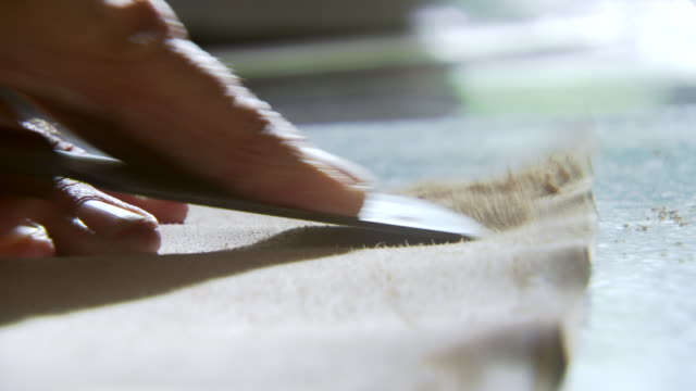 ecu shot of hands use  blade to scrape piece of leather that will become book cover / williamsburg, virginia, united states - book cover stock videos & royalty-free footage