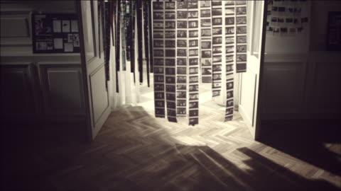 shot of hanging film in a row with light - fotografi konst och konsthantverksföremål bildbanksvideor och videomaterial från bakom kulisserna