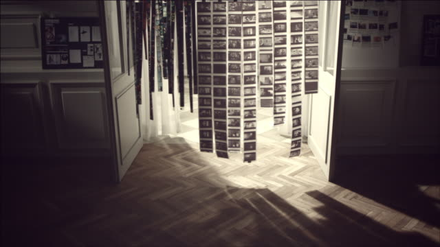 shot of hanging film in a row with light - fotografische themen stock-videos und b-roll-filmmaterial