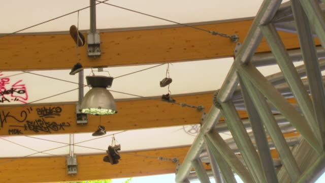 stockvideo's en b-roll-footage met ms shot of hanging shoes / paris, france - middelgrote groep dingen